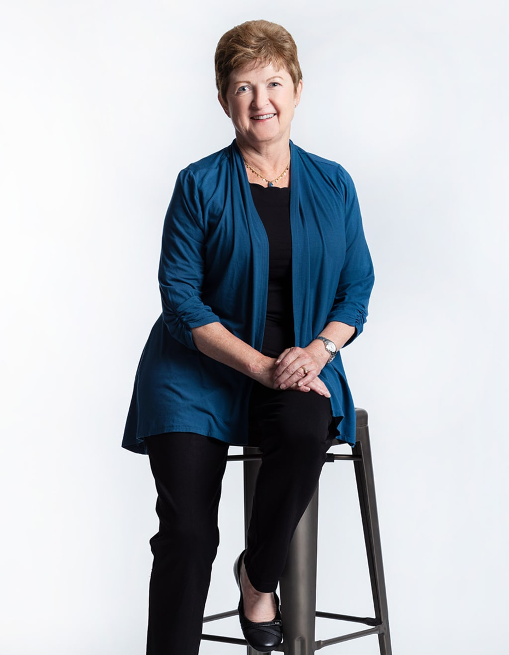 Jan Eddy sitting on a chair