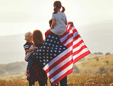 family carrying a flag